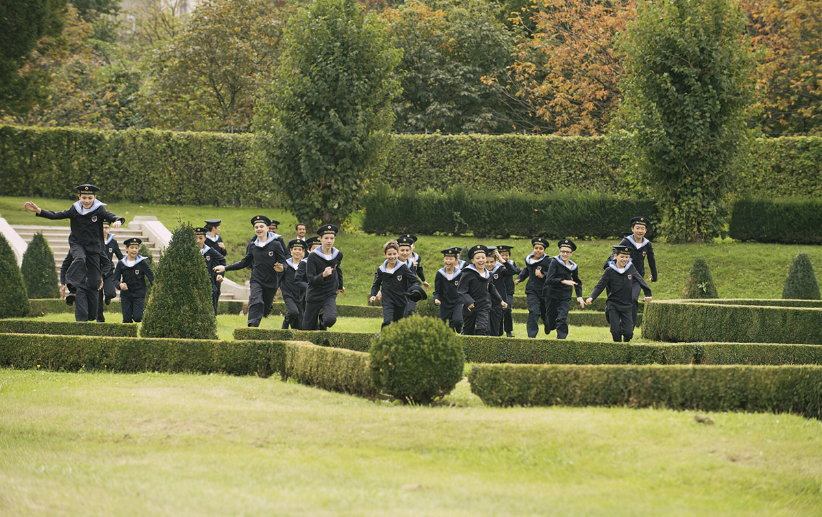 The Vienna Boys' Choir playing in the garden